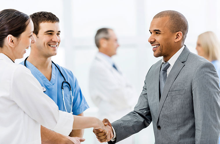 Businessman-shaking-hands-with-a-doctor-000032829234_Full
